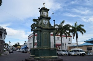The four-sided clock still stands in the centre of the Circus, Basseterre. Bank Street, where Oliver's practice was located, is straight ahead beyond the memorial.